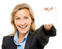 Happy mature business woman holding white placard isolated on wh Royalty Free Stock Photo