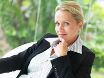 Happy mature business woman sitting on a chair Stock Photography