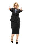 Happy mature business woman thumbs up isolated on white backgrou. Happy mature business woman showing thumbs up full length Stock Image