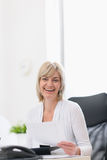 Happy mature business woman working at office stock photography