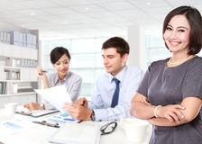Happy mature business women with her two staff behind Stock Photography