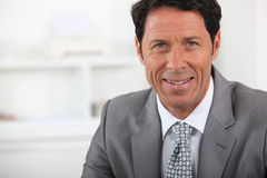 Happy mature businessman Royalty Free Stock Image