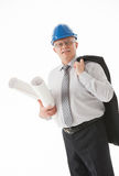 Happy mature businessman in a blue helmet holding projects Royalty Free Stock Photography
