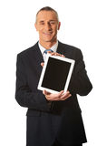Happy mature businessman holding digital tablet Royalty Free Stock Photo