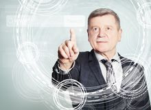 Happy mature businessman pointing to empty address bar in virtual web browser.  royalty free stock photo