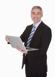 Happy Mature Businessman Using Laptop Stock Images