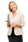Happy mature businsswoman holding clipboard isolated on white ba Stock Images
