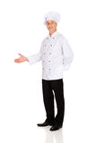 Happy mature chef with welcome gesture Royalty Free Stock Image