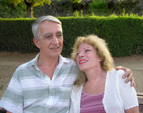 Happy mature couple. Romantic mature couple sitting on a bench Royalty Free Stock Photography