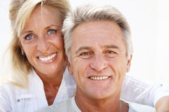 Happy mature couple. Smiling over white background royalty free stock photography