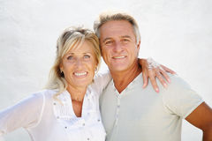 Happy mature couple. Smiling over white background royalty free stock photos