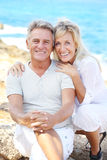Happy mature couple. Smiling and embracing outdoors royalty free stock images