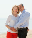 Happy  mature couple against sea Royalty Free Stock Photography