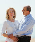 Happy mature couple against sea Stock Images