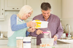 Happy mature couple baking together Royalty Free Stock Photos