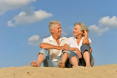 Happy mature couple barefoot Stock Images