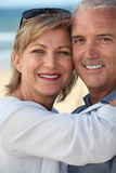 Happy mature couple at beach Royalty Free Stock Images
