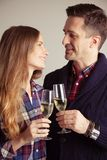 Couple clinking glasses of champagne Stock Photography