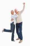 Happy mature couple cheering at camera Stock Image