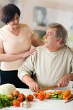 Happy mature couple cooking Royalty Free Stock Photo
