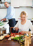 Happy mature couple cooking healthy food Royalty Free Stock Photography