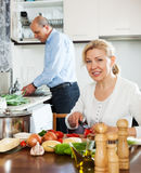 Happy mature couple cooking soup Royalty Free Stock Photography