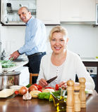 Happy mature couple cooking together Stock Image