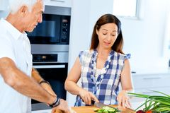 Married couple cooking at home. Happy mature couple cooking together at home Stock Photography