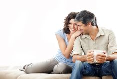 Happy mature couple on couch - Copyspace Stock Photo