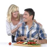 Happy mature couple cutting vegetables Royalty Free Stock Photos