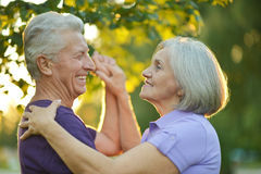 Happy Mature couple. Dancing in autumn park on sunset Stock Photography