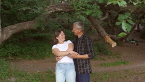 Happy Mature couple dancing in Park, slow motion.