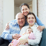 Happy mature couple with daughter and granddaughter Stock Images