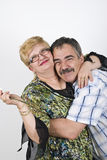 Happy mature couple embracing royalty free stock images