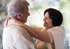Happy mature couple embracing or dancing. Happy old couple embracing or dancing, outside Royalty Free Stock Photo