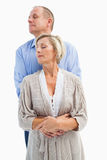 Happy mature couple embracing with eyes closed Royalty Free Stock Image