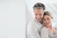 Happy mature couple embracing at home Royalty Free Stock Photo