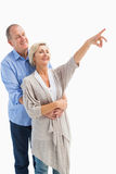 Happy mature couple embracing and looking Stock Photography