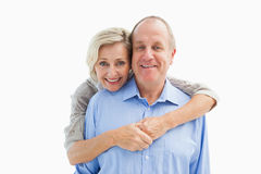 Happy mature couple embracing smiling at camera Stock Photography