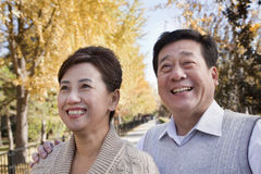 Happy Mature Couple Enjoying the Park in Autumn Royalty Free Stock Photo