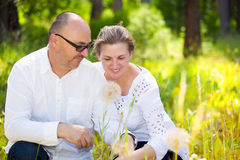 Happy mature couple enjoying weekend day in a park Stock Images