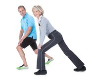 Happy mature couple exercising Stock Photos