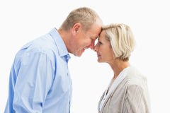 Happy mature couple facing each other Royalty Free Stock Photo