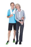 Happy mature couple in fitness attire Stock Photography