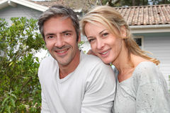 Happy mature couple in front of their new home Royalty Free Stock Photo