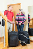 Happy mature couple  going on holiday. Happy mature couple with luggage   near door going on holiday Stock Photography