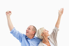 Happy mature couple with hands up Stock Images