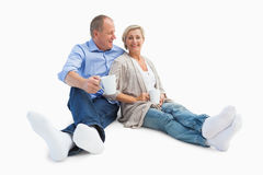Happy mature couple having coffee Royalty Free Stock Photo