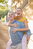 Happy mature couple having fun in the city Stock Images