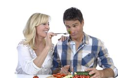 Happy mature couple having fun while cooking Royalty Free Stock Photography